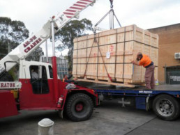 transporting timber boxes carefully