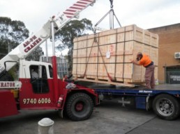 Transporting timber machinery containers in Sydney