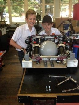 school students working on building the robot